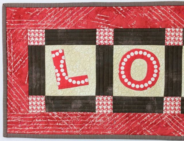 "Detail of Completed Quilting ""Love"" Tablerunner"