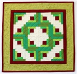 """Log Cabin Wreath, Pieced and Quilted by Christa Wason 18"""" x 18"""""""