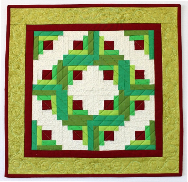 "Log Cabin Wreath, Pieced and Quilted by Christa Wason 18"" x 18"""