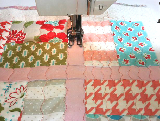 Beautiful Fabric Being Quilted on a Sewing Machine