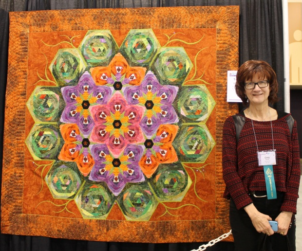 "Cory and her show-stopping collaboration quilt, ""Lilypad"". Pieced by Patti Van Oordt"