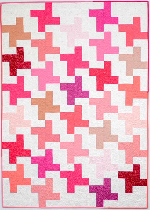 Pink quilt with allover loopy machine quilting. From The Quilter's Path Craftsy class by Christa Watson.