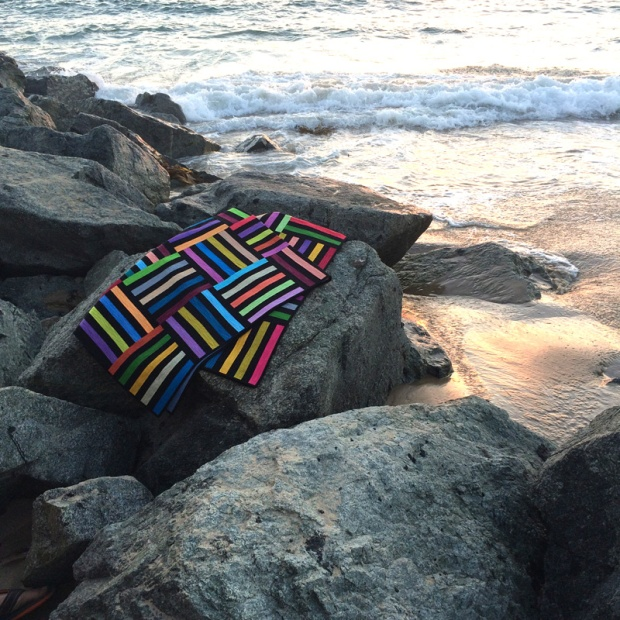 Photo shoot of quilts on the beach
