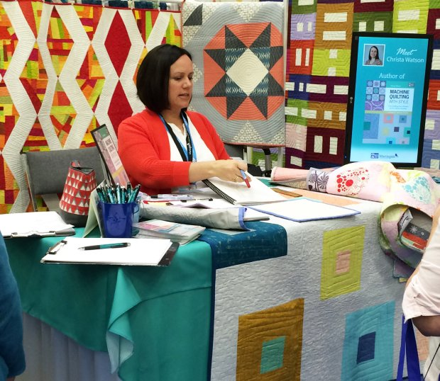 Christa at Quilt Market 2015