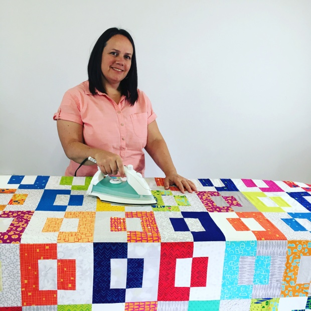 Iron the basted quilt