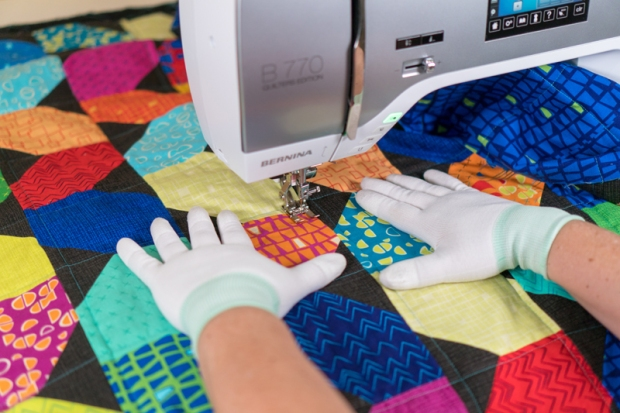 Use gloves to move the quilt