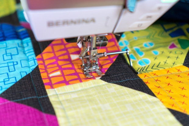 Using a guide bar for quilting