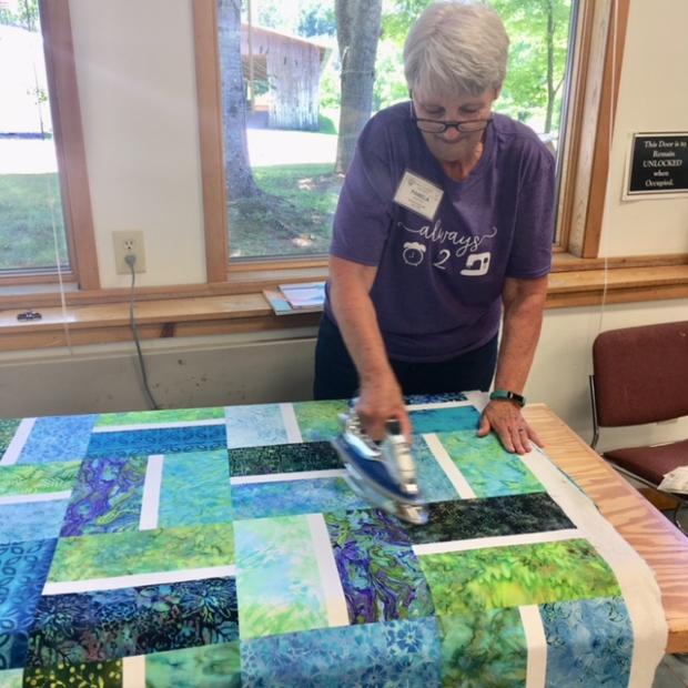 Quilt Basting - pressing the quilt