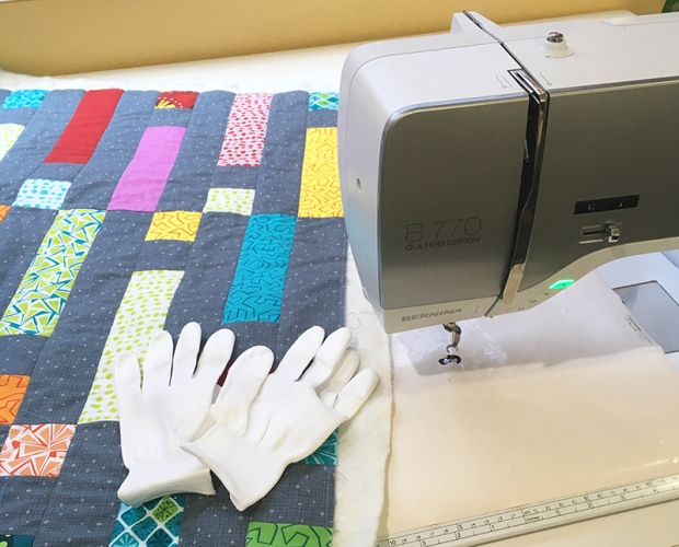 Tools for free motion quilting: open toe foot, gloves, supreme slider