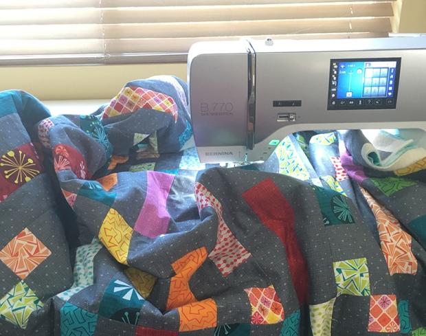 Scrunch and Smoosh the quilt under the machine