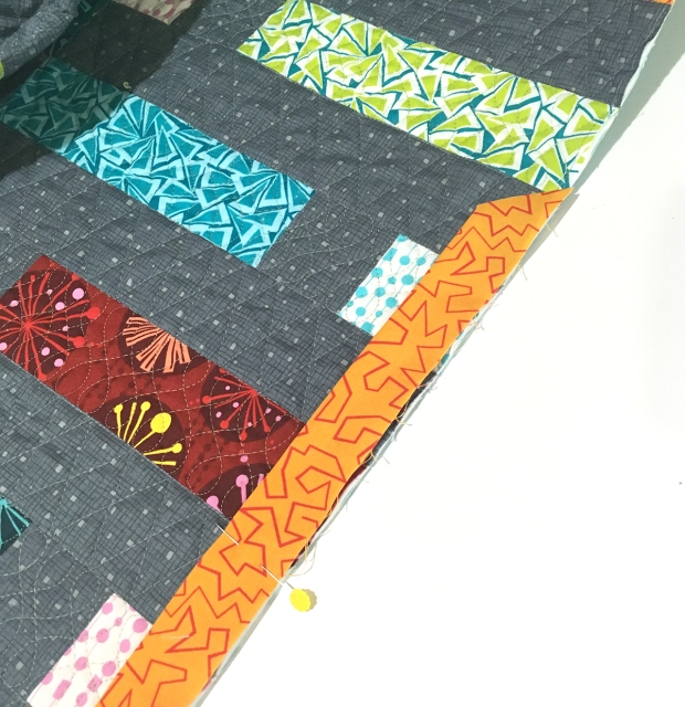 Attach binding to quilt