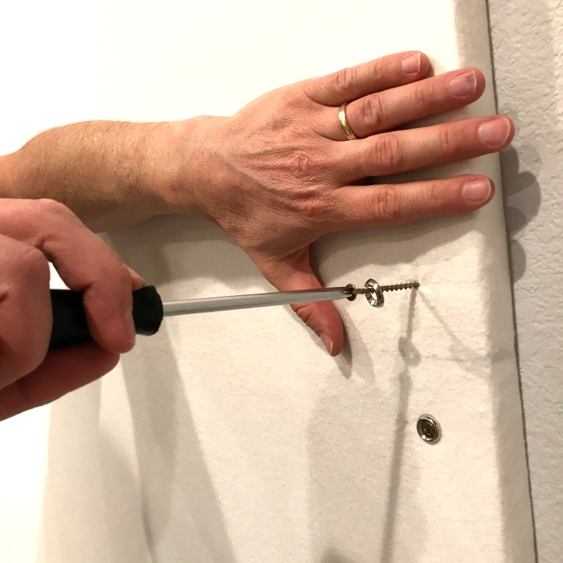 Attaching the screws in the design wall
